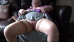 Mature granny with massive tits and wooly pubic hair stripping and teasing