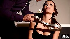 Russian Dominatrix Anna Polina pours loads of hot paraffin wax all over Tasha Holz