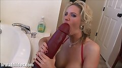 Chesty blonde mummy Zoe fills her pussy with a huge dildo